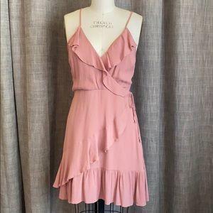 Mauve ruffle wrap dress with side zip.